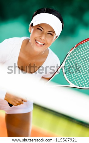 Woman in sportswear playing tennis. Competition
