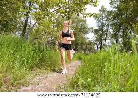 Woman in sportswear running in a park