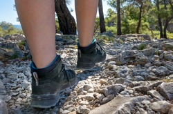Woman in sturdy hiking shoes on technical trail close up