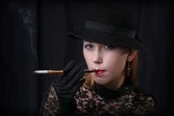 woman  in style of 1930-1940 with cigarette