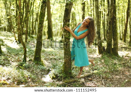 woman in summer forest