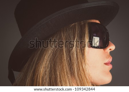 woman in sun glasses in profile