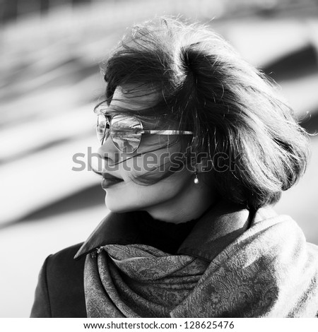 Woman in sunglasses looking away