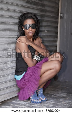 Woman in the alley wearing sunglasses - stock photo