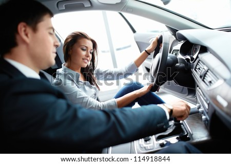 Woman in the car and seller