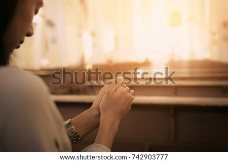 woman in the church and prays...
