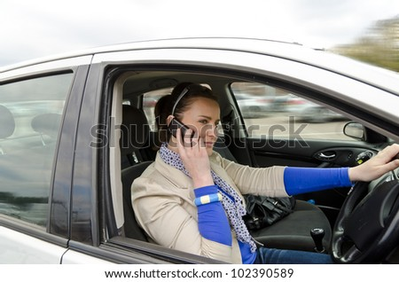 woman in the driving and call up