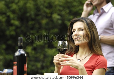 Woman in the garden  with wine