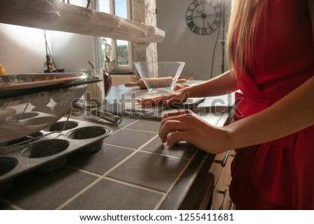 woman in the kitchen is preparing something for Christmas