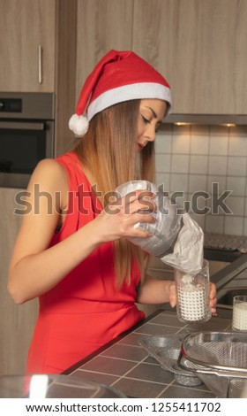 woman in the kitchen is preparing something for Christmas, side view