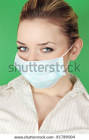 woman in the medical bandage against the green background