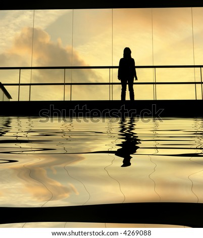 woman in the modern building at sunset