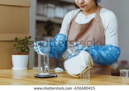 Woman in the process of homemade soap making. Shallow depth of field.