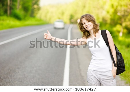 woman in the road auto-stop