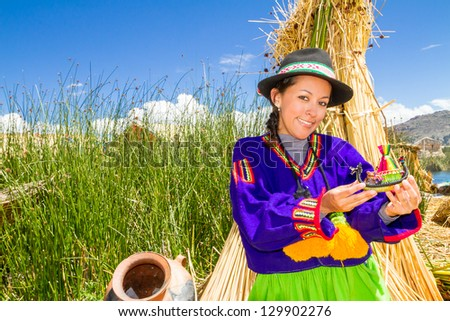 Woman in traditional clothes, lake Titicaca Puno Peru South America