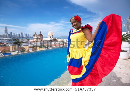 Woman in traditional costume against the backdrop of Cartagena de Indias, Colombia