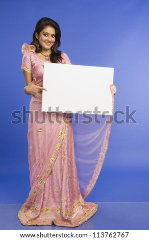Woman in traditional dress and holding a blank placard