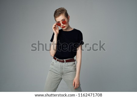 woman in trousers and in a vest, red glasses                            #1162471708
