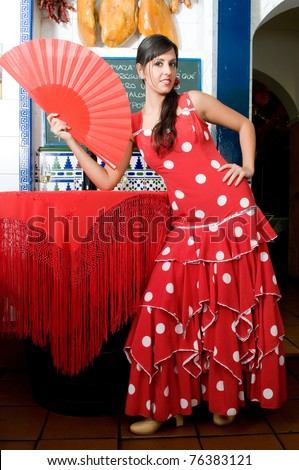 stock photo : woman in typical spanish restaurant with flamenco dresses and jam