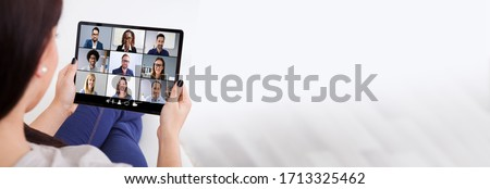 Woman In Video Conferencing Call On Tablet. Webinar Conference