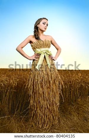 woman in wheat field under blue sky