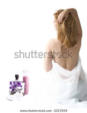 woman in white cloth with bath essentials