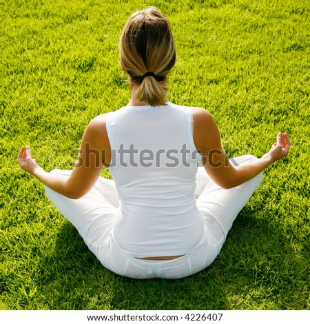 Woman in white doing yoga in dawn light