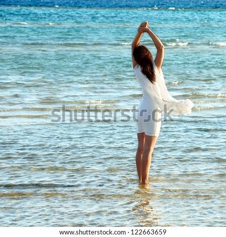 woman in white dress in blue sea water