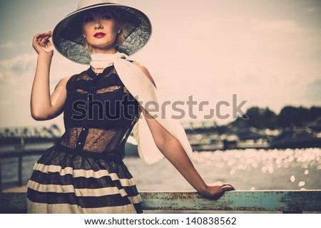 woman in white hat and scarf...