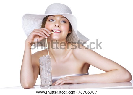 Woman in white hat with glass full of ice and cold water. Hot summer concept.