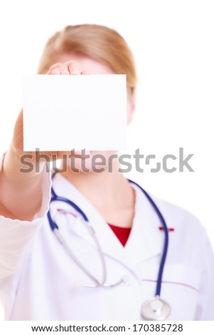 Woman in white lab coat recommending your product. Doctor or nurse with stethoscope holding blank copy space card isolated. Medical person for health insurance. - stock photo