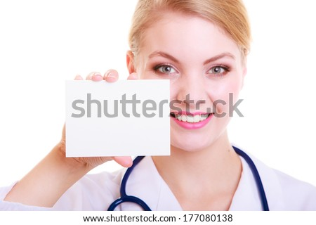 Woman in white lab coat recommending your product. Doctor or nurse with stethoscope holding blank copy space card isolated. Medical person for health insurance.