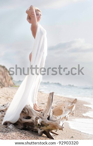 Woman in white on the beach