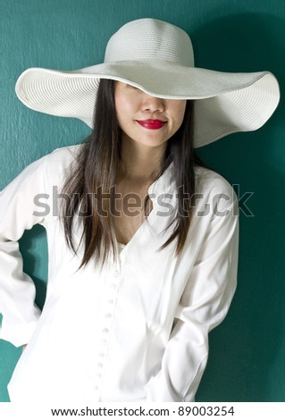 woman in white shirt on green background