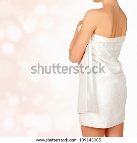 Woman in white towel, abstract background with circles and copyspace