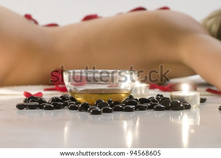 Woman in white towel relaxing in spa - stock photo