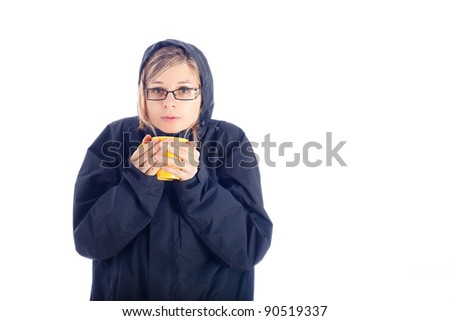 Woman in winter jacket holding mug with hot drink, isolated on white background.