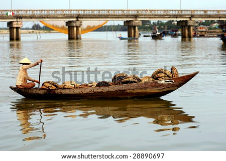 Woman in wooden boat, Hoi An, Vietnam