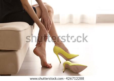 Woman in yellow high heels shoes. #426712288