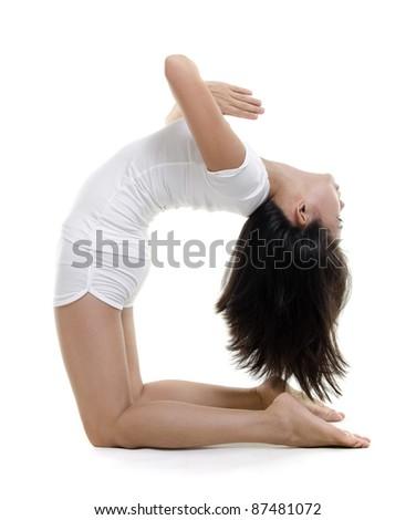 woman in yoga camel posture ustrasana on white