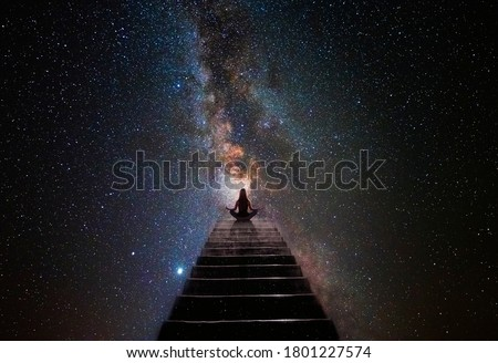 Woman in yoga pose at top of stair Stock photo ©