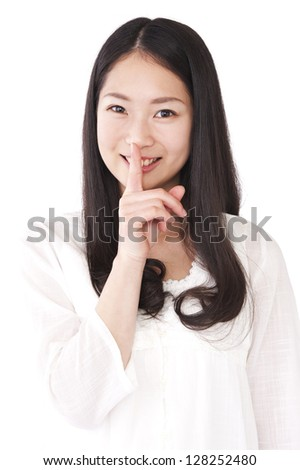 Woman index finger against the mouth