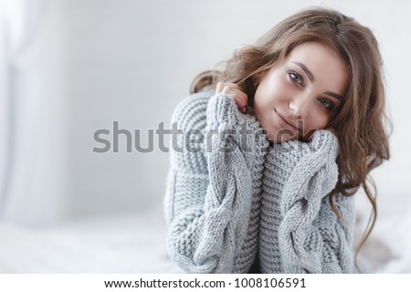 woman indoor portrait. Young beautiful woman in warm knitted clothes at home. fashion. Autumn, winter #1008106591