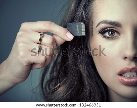 woman inserting card into her head