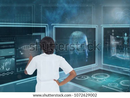 Woman interacting with medical interfaces against blue background with flares #1072629002