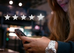 Woman internet shopping on smartphone submitting 5 silver star satisfaction feedback - Millennial girl replying to customer experience survey questions by email - Review, success & retention concept