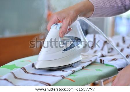 Woman ironing #61539799