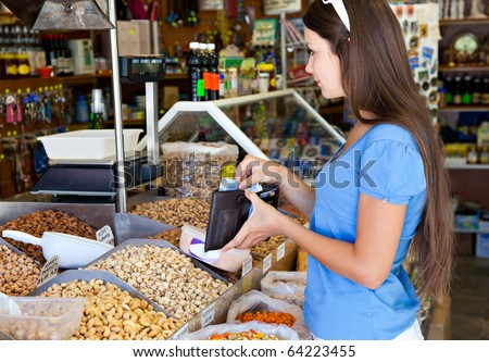 Woman is buying in food-shop
