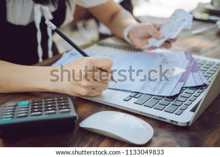 woman is checking credit card bill information Stock photo ©