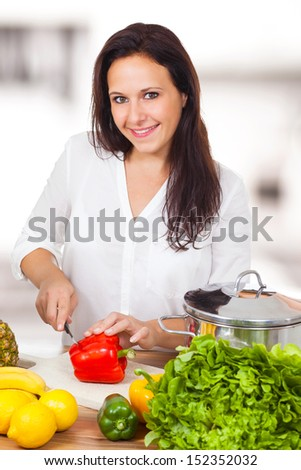 Woman is cooking healthy in the kitchen